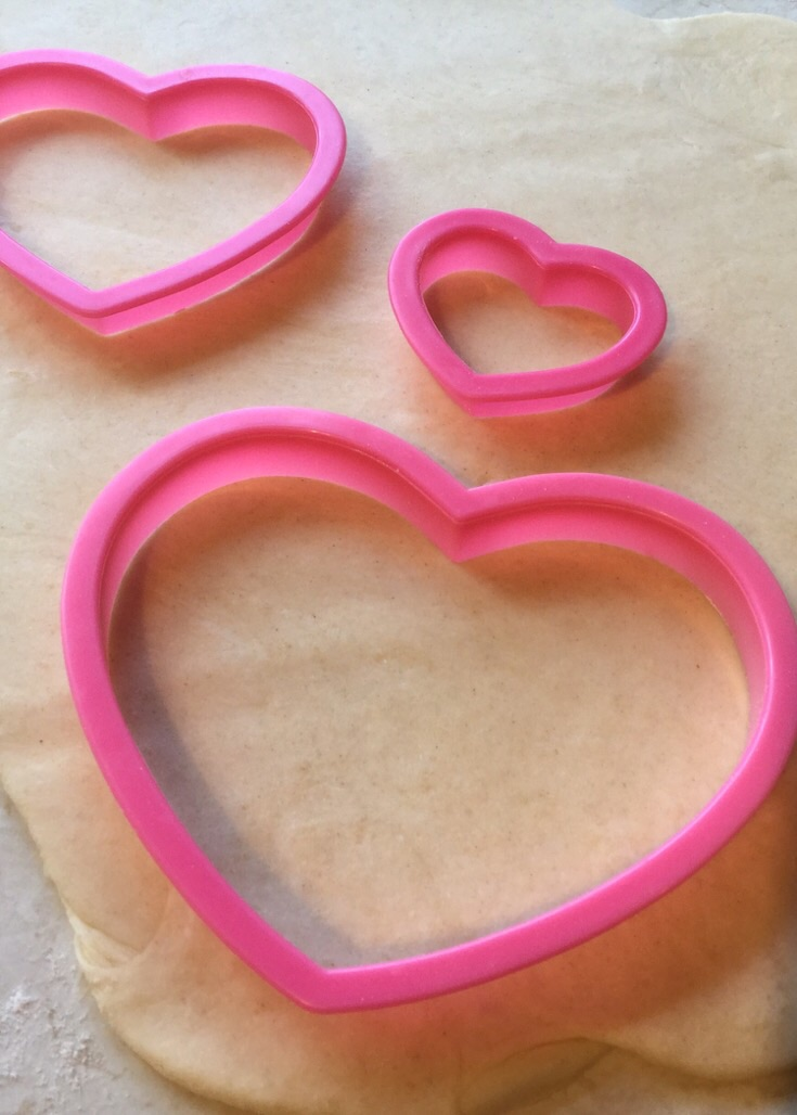 Heart shaped pastry cutters to make a romantic decoration for a pie